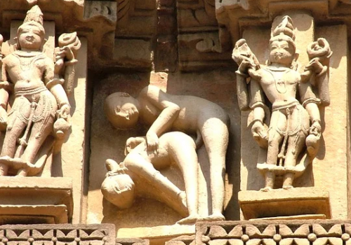A carving from khajuraho, depicting a sexual position
