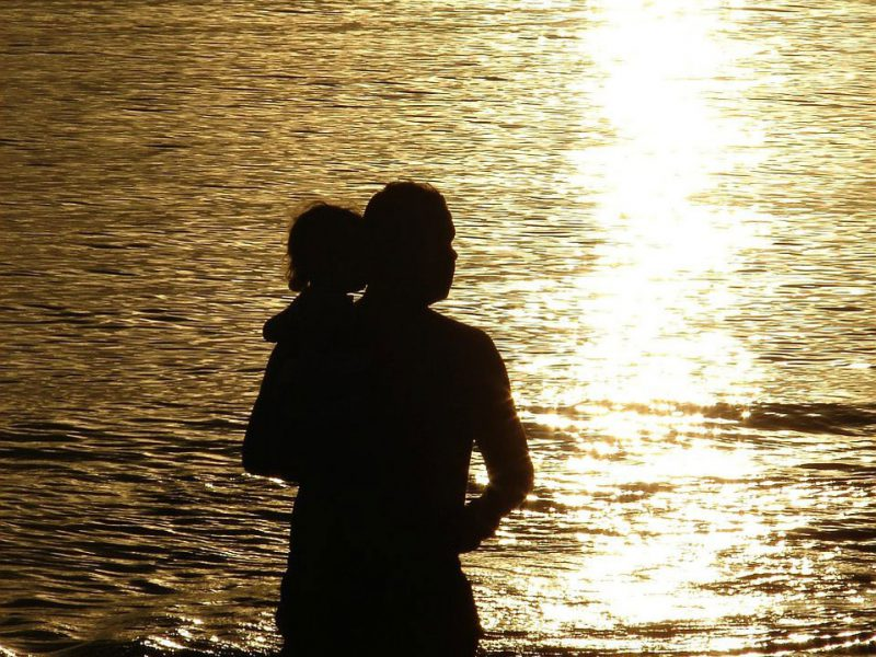a gay man's daughter: silhouette of a man holding up his daughter