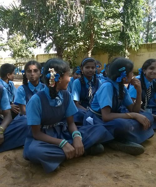 An image showing a group of adolescent girls sitting together