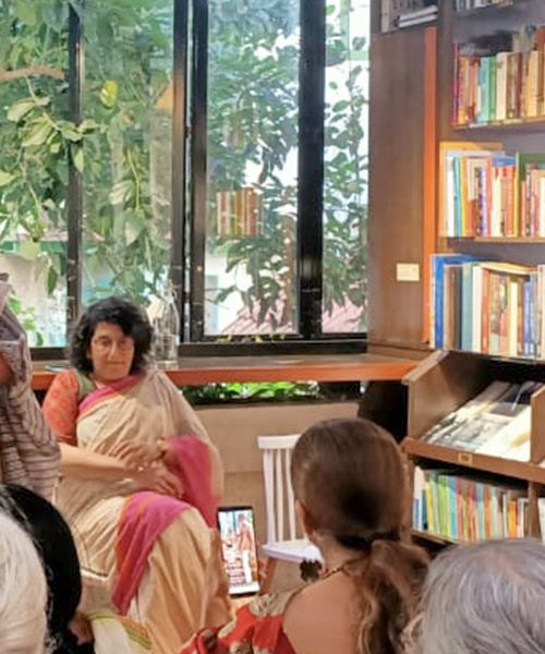 A photograph of Kalpana Sharma, Sharda Ugra, and attendees at an event around the book 'Single by Choice: Happily Unmarried Women'.