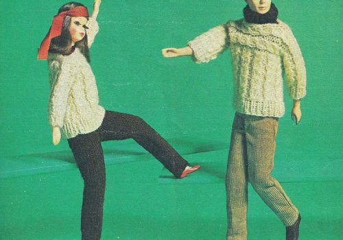 Image of two dolls swaying their legs and arms. The doll on the left has long hair and is wearing a red coloured head scarf on its head and a white sweater and black pants. The doll also has makeup on its face. The doll on the rights has short hair and is wearing a white sweater with grey pants. The doll has a black woolen scarf around its neck