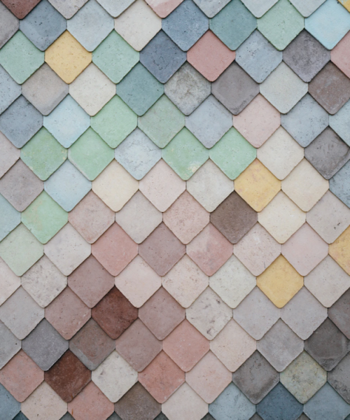 A zoomed-in photograph of a wall with differently coloured flanks.
